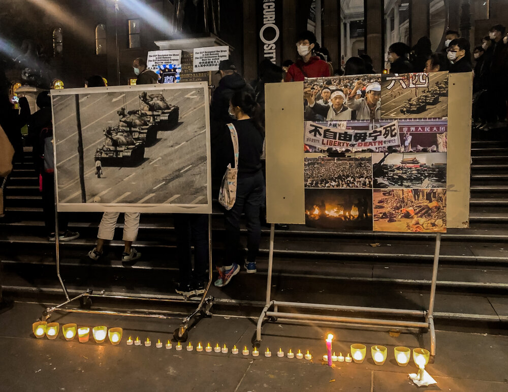 The most famous image from the Tiananmen Square student protests of 1989, 'Tank Man', displayed on the steps of the Victorian State Library, June 4 2020. Photo by Oliver Lees.